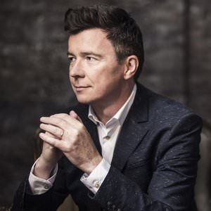 Rick Astley - It Would Take A Strong Strong Man Lyrics